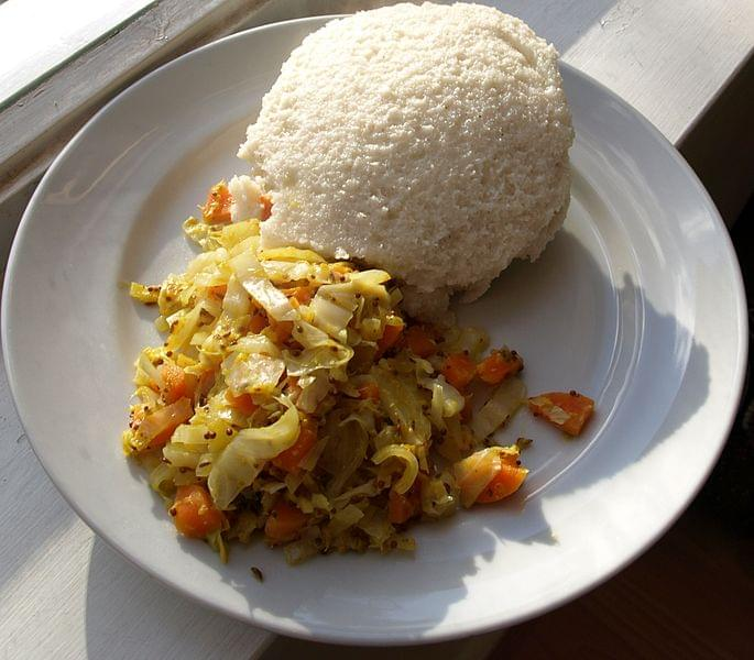 piatto tipico ugali and cabbage